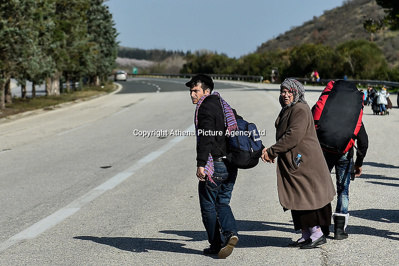 Pictured: Migrants of all ages, carrying their belongings, walk on the motorway to get to Idomeni, Greece Wednesday 02 March 2016<br /> Re: More migrants have been arriving at the Greek FYRO Macedonian border of Idomeni, Greece.