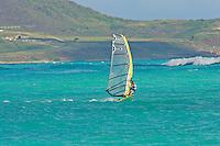 Windsurfer takes advantage of windy conditions at Kailua beach on the island of Oahu, Hawaii.