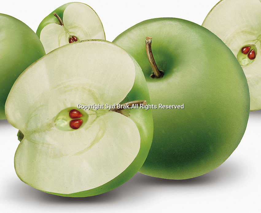 Close up of whole and halved green apples