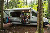 USA, Oregon, Santiam River, Brown Cannon, young boys hanging out in a travel van in a campground near the Santiam River in the Willamete National Forest