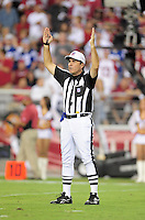 Sept. 27, 2009; Glendale, AZ, USA; NFL referee Pete Morelli signals touchdown during the game between the Arizona Cardinals against the Indianapolis Colts at University of Phoenix Stadium. Indianapolis defeated Arizona 31-10. Mandatory Credit: Mark J. Rebilas-