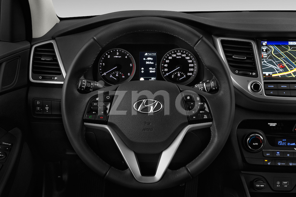 Car pictures of steering wheel view of a 2015 Hyundai Tucson Launch Edition 5 Door Suv Steering Wheel