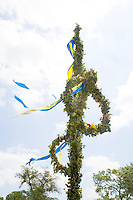 Midsommar Pole with yellow and blue ribbons. Svenskarnas Dag Swedish Heritage Day Minnehaha Park Minneapolis Minnesota USA
