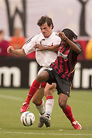The MetroStars' Fabian Taylor battles for the ball with D.C. United's Ryan Nelsen. D. C. United was defeated by the NY/NJ MetroStars 3 to 2 during the MetroStars home opener at Giant's Stadium, East Rutherford, NJ, on April 17, 2004.