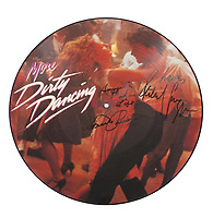 "COPY BY TOM BEDFORD<br /> Pictured: A signed Dirty Dancing 12 inch vinyl record once belonged to actor Patrick Swayze that was sold at auction<br /> Re: The iconic black leather jacket worn by Patrick Swayze in the hit film Dirty Dancing has sold for $50,000 (£38,612) at auction.<br /> It was bought by a fan after the tragic actor's wife decided to sell his movie memorabilia. <br /> The jacket had a reserve of just $6,000(£4,630) at the auction in Los Angeles but an internet bid of $25,000(£19,300) was received before the auction started.<br /> The salesroom erupted with applause when the hammer came down at $50,000.<br /> Auctioneer Darren Julien said: ""We always knew it would fetch big bucks.<br /> ""The jacket is the holy grail for Patrick Swayze fans and there are a lot out there.""  <br /> The heart throb actor wore the James Dean-style jacket throughout Dirty Dancing including the  scene where he says: ""Nobody puts Baby in a corner"".<br /> The jacket belonged to Swayze before the movie was made in 1987.<br /> Dirty Dancing was a low-budget movie and most of the clothes Swayze's wore were his own, including the leather jacket.<br /> Mr Julien said: ""Because it was his jacket he got to keep it after the movie and wore it whenever he felt like it."