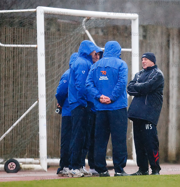 Walter Smith chatting to a group of Dutch coaches in the rain at Murray Park