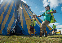 NWA Democrat-Gazette/BEN GOFF @NWABENGOFF<br /> Lenny Martinez (left) and Nacho Gaspar help set up the big top tent Thursday, Sept. 6, 2018, for the Carson &amp; Barnes Circus at the Metroplex Event Center in Rogers. The 'Circus Saurus' shows, featuring a dinosaur theme along with traditional circus acts, begin tonight at 7:30 p.m. and continue Friday, Saturday and Sunday. The stop in Rogers was moved from it's planned location at Frisco Station Mall.