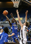Desert Pines' Nate Grimes shoots over Elko defender Brian Pearson during a Division IA semi-final game in the NIAA state tournament at Lawlor Events Center, in Reno, Nev., on Friday, Feb. 28, 2014. Elko won 63-47. (Cathleen Allison/Las Vegas Review-Journal)