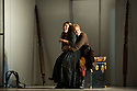 London, UK. 14.10.2014. English National Opera presents THE MARRIAGE OF FIGARO, directed by Fiona Shaw, at the London Coliseum. Picture shows:  Mary Bevan (Susanna) and Samantha Price (Cherubino). Photograph © Jane Hobson.