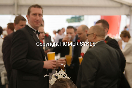 The Vodaphone Derby Day Horse Racing. Epsom Downs, Surrey, England 2007. Woman with typical hat in beer tent.