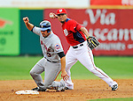 10 March 2011: Washington Nationals' pitcher Ian Desmond gets Mike Nickeas out at second during a Spring Training game against the New York Mets at Space Coast Stadium in Viera, Florida. The Nationals edged out the Mets 6-5 in Grapefruit League play. Mandatory Credit: Ed Wolfstein Photo