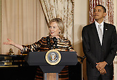United States Secretary of State Hillary Clinton introduces President Barack Obama during the Diplomatic Corps Holiday Reception at the State Department, December 13, 2010 in Washington, DC. The State Department was bruised by the release last month of some of the 250,000 diplomatic cables obtained by the whistleblower Web site Wikileaks. .Credit: Chip Somodevilla - Pool via CNP
