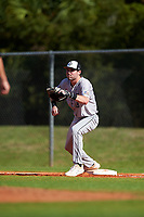 Northeastern Huskies first baseman Jake Farrell (18) stretches for a throw during a game against the South Dakota State Jackrabbits on February 23, 2019 at North Charlotte Regional Park in Port Charlotte, Florida.  Northeastern defeated South Dakota State 12-9.  (Mike Janes/Four Seam Images)