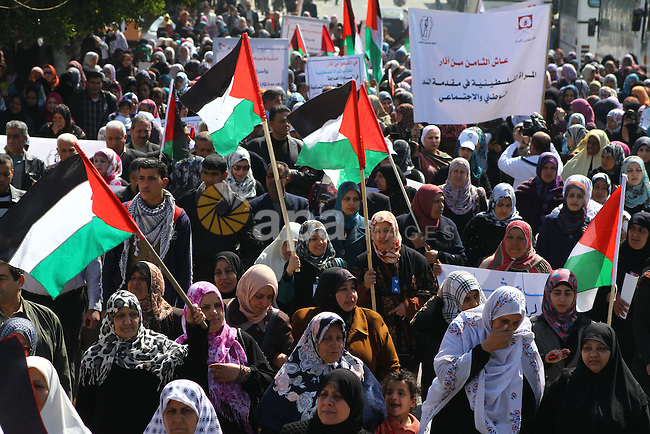 A Palestinian woman hold a poster during a protest calling for the release of Hana Shalabi, a female Palestinian prisoner jailed in Israel who has been on hunger strike for 22 days, outside the Red Cross building in Gaza City, 08 March 2012. Palestinian sources say that Shalabi is protesting against the Israeli administrative detention, which apparently is a law imposed against Palestinian prisoners under which they can be detained for months without a charge or trial.  Photo by Ashraf Amra