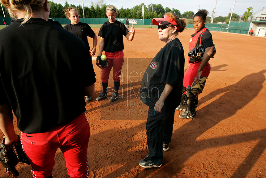 UGA softball coach and mother of two Lu Harris-Champer speaks with the team during practice in Athens, Ga. on Wednesday, May 27, 2006. She is due to give birth to another daughter next week. Her husband, Jerry Champer, is an assistant coach for the UGA swimming team.