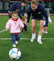 United States defender Christie Rampone (3) plays soccer with a child after the game. The women's national team of the United States defeated Canada 6-0 during an international friendly at Robert F. Kennedy Memorial Stadium in Washington, D. C., on May 10, 2008.
