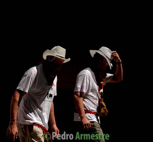 participants are seen during the San Fermin Festival, on July 10, 2012, in Pamplona, northern Spain. The festival is a symbol of Spanish culture that attracts thousands of tourists to watch the bull runs despite heavy condemnation from animal rights groups . (c) Pedro ARMESTRE