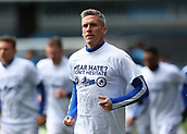 17th March 2019, The Den, London, England; The Emirates FA Cup, quarter final, Millwall versus Brighton and Hove Albion; Steve Morison of Millwall along with other Millwall players wearing Hear Hate? Don't Hesitate T-Shirt in response to the recent racist and homophobic allegations against Millwall inside The Den before kick off