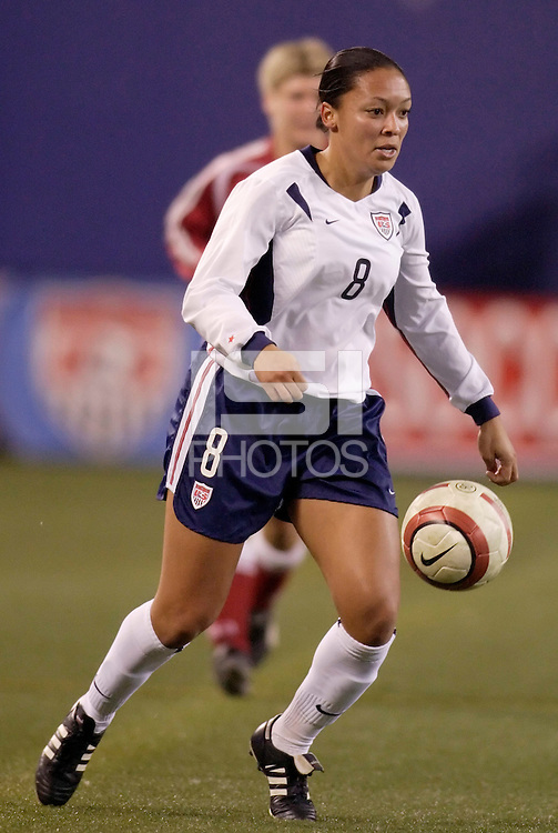 "USA's Angela Hucles. The US Women's National Team tied the Denmark Women's National Team 1 to 1 during game 8 of the 10 game the ""Fan Celebration Tour"" at Giant's Stadium, East Rutherford, NJ, on Wednesday, November 3, 2004.."