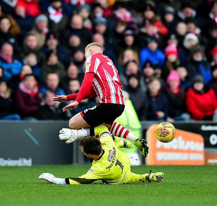 Lincoln City's Danny Rowe is fouled by Grimsby Town's James McKeown, who was then sent off<br /> <br /> Photographer Andrew Vaughan/CameraSport<br /> <br /> The EFL Sky Bet League Two - Lincoln City v Grimsby Town - Saturday 19 January 2019 - Sincil Bank - Lincoln<br /> <br /> World Copyright © 2019 CameraSport. All rights reserved. 43 Linden Ave. Countesthorpe. Leicester. England. LE8 5PG - Tel: +44 (0) 116 277 4147 - admin@camerasport.com - www.camerasport.com