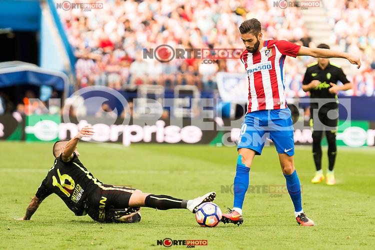 "Atletico de Madrid's player Yannick Carrasco and Sporting de Gijon's player Manuel ""Lillo"" Castellano during a match of La Liga Santander at Vicente Calderon Stadium in Madrid. September 17, Spain. 2016. (ALTERPHOTOS/BorjaB.Hojas) /NORTEPHOTO"