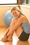portrait of young woman working out and getting in shape with weights and yoga