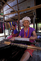 Flower Hmong hilltribe woman working on traditional wooden hand lap loom, Chiang Mai, Thailand