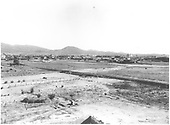 A view of Santa Fe from the St. Catharine's Indian School grounds.  The Texas, Santa Fe and Northern track is in the foreground.<br /> TSF&amp;N  Santa Fe, NM  Taken by Gueran, T. J. - 1890