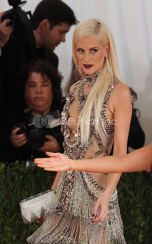 05 02 2016: Poppy Delevingne at Manus X Machina: Fashion In An Age of Technology at Metropolitan Museum of Art in New York. Credit:RWMediaPunch