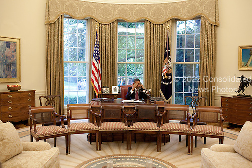 Washington, DC - June 26, 2009 -- United States President Barack Obama calls a foreign leader from the Oval Office, June 26, 2009.    .Mandatory Credit: Pete Souza - White House via CNP
