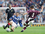 Derek McInnes steams in on Paul Ritchie of Hearts in the red card game of Sept 14th 1996