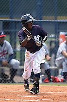 GCL Yankees 1 shortstop Jorge Mateo (11) squares to bunt during the second game of a doubleheader against the GCL Braves on July 1, 2014 at the Yankees Minor League Complex in Tampa, Florida.  GCL Braves defeated the GCL Yankees 1 by a score of 3-1.  (Mike Janes/Four Seam Images)