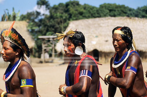 Bacaja village, Amazon, Brazil. Young men dancing with artifacts during the hornets' nest initiation ceremony; Xicrin tribe.