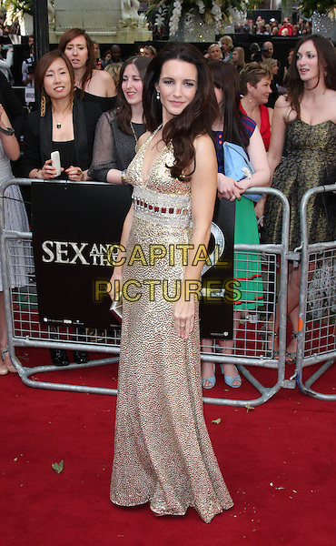 KRISTIN DAVIS in Norman Norell.Arrivals to the 'Sex And The City 2' European Premiere at the Odeon, Leicester Square, London .May 27th, 2010.full length gold sequined sequins beaded beads maxi sleeveless dress gown clutch bag gem encrusted jewel embellished metallic halterneck.CAP/ROS.©Steve Ross/Capital Pictures.