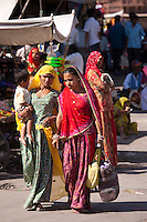 Indian women shopping, street scene at Sardar Market at Girdikot, Jodhpur, Rajasthan, Northern India