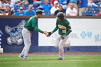 Lynchburg Hillcats manager Mark Budzinski (7) low fives Claudio Bautista (10) after hitting a home run during a game against the Wilmington Blue Rocks on June 3, 2016 at Judy Johnson Field at Daniel S. Frawley Stadium in Wilmington, Delaware.  Lynchburg defeated Wilmington 16-11 in ten innings.  (Mike Janes/Four Seam Images)