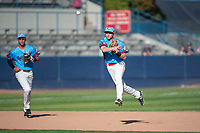 Spokane Indians shortstop Jax Biggers (1) throws to first base as third baseman Diosbel Arias (21) watches the play during a Northwest League game against the Vancouver Canadians at Avista Stadium on September 2, 2018 in Spokane, Washington. The Spokane Indians defeated the Vancouver Canadians by a score of 3-1. (Zachary Lucy/Four Seam Images)