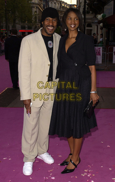 "DANNY JOHN JULES & GUEST.""Confetti"" world premiere at Vue West End, London, UK..May 3rd, 2006.Ref: CAN.full length beige suit black dress.www.capitalpictures.com.sales@capitalpictures.com.©Capital Pictures"