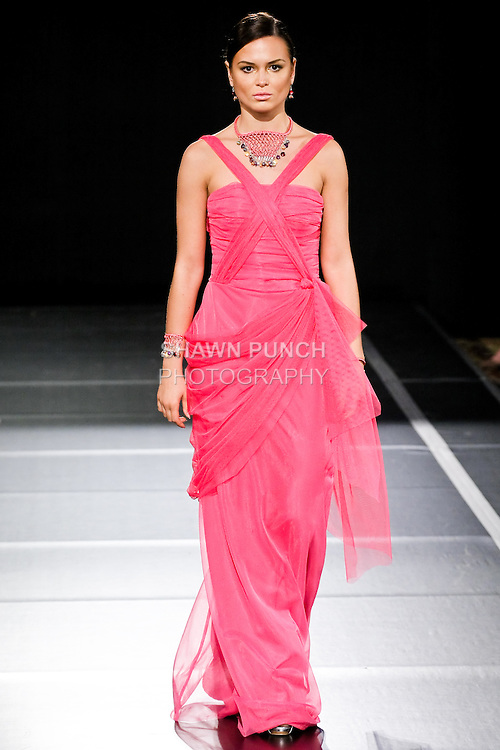 Model walks the runway in an outfit by Paulina Lopez for the Paulina Lopez Spring Summer 2011 Rainbow collection fashion show, during Couture Fashion Week, September 10, 2010.