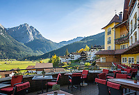 Austria, Tyrol, Lermoos: terrace restaurant of Hotel Post, view at Mieminger mountains | Oesterreich, Tirol, Lermoos: Terrasse des Hotels Post vorm Mieminger Gebirge