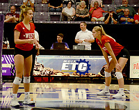 Graham Thomas/Siloam Sunday<br /> Former Siloam Springs volleyball standouts Chloe Price and Ellie Lampton get in position for the West All-Stars on Friday during the Arkansas High School Coaches Association Volleyball Game at the Farris Center on the campus of the University of Central Arkansas. The East won four straight games to defeat the West 4-1.