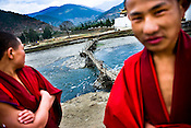 Young Buddhist monks seen against the Pho Chhu river next to the Punakha dzong in Punakha, Bhutan. Phunakha was the capital of Bhutan and the seat of government until 1955, when the capital was moved to Thimphu. Punakha is the administrative centre of Punakha dzongkhag, one of the 20 districts of Bhutan. Photo: Sanjit Das/Panos