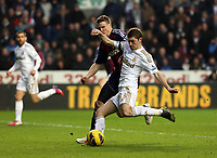 Saturday 19 January 2013<br /> Pictured: Ben Davies of Swansea (R) against Ryan Shawcross (L) scoring the opening goal.<br /> Re: Barclay's Premier League, Swansea City FC v Stoke City at the Liberty Stadium, south Wales.