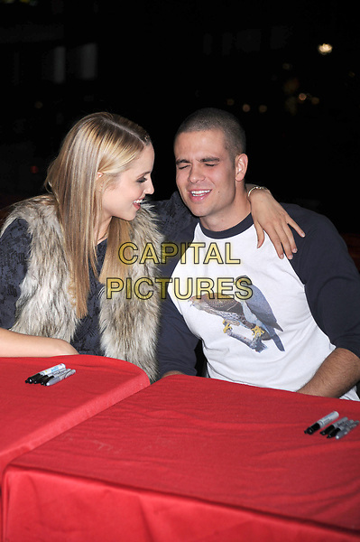 'Glee' star Mark Salling is reported dead at 35 of apparent suicide. He was awaiting sentencing on child pornography charges.<br /> ***FILE PHOTO*** Dianna Agron and Mark Salling at the Glee Season One cd release at Borders Columbus Circle in New York City. November 3, 2009.. <br /> CAP/MPI/DVT<br /> &copy;DVT/MPI/Capital Pictures