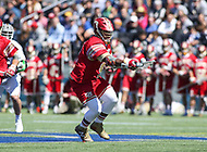 Washington, DC - March 31, 2018: Denver Pioneers Trevor Baptiste (9) wins the faceoff during game between Denver and Georgetown at  Cooper Field in Washington, DC.   (Photo by Elliott Brown/Media Images International)
