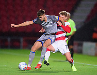 Lincoln City's Ellis Chapman battles with do7`<br /> <br /> Photographer Andrew Vaughan/CameraSport<br /> <br /> EFL Leasing.com Trophy - Northern Section - Group H - Doncaster Rovers v Lincoln City - Tuesday 3rd September 2019 - Keepmoat Stadium - Doncaster<br />  <br /> World Copyright © 2018 CameraSport. All rights reserved. 43 Linden Ave. Countesthorpe. Leicester. England. LE8 5PG - Tel: +44 (0) 116 277 4147 - admin@camerasport.com - www.camerasport.com