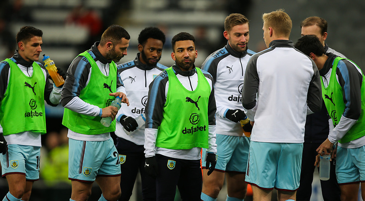 Burnley's Aaron Lennon takes a break with teammates during the warm up<br /> <br /> Photographer Alex Dodd/CameraSport<br /> <br /> The Premier League - Newcastle United v Burnley - Wednesday 31st January 2018 - St James' Park - Newcastle<br /> <br /> World Copyright &copy; 2018 CameraSport. All rights reserved. 43 Linden Ave. Countesthorpe. Leicester. England. LE8 5PG - Tel: +44 (0) 116 277 4147 - admin@camerasport.com - www.camerasport.com