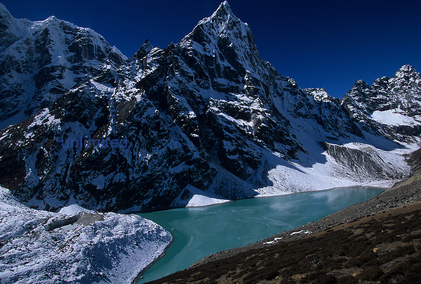 Duglha elevation fifteen thousand and ninety two feet Chola Lake, Tshola Glacier with Cholotse and Taweche Peaks in background. Solu-Khumbue trek, Nepal