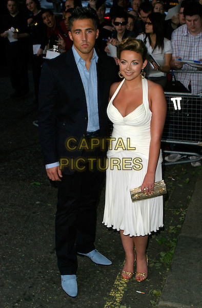 GAVIN HENSON & CHARLOTTE CHURCH.The Glamour Magazine 3rd Annual Women Of The Year Awards - Arrivals, Berkeley Square, London, England, .June 6th 2006..full length white halterneck dress couple blue suit shirt gold shoes clutch bag.REf: AH.www.capitalpictures.com.sales@capitalpictures.com.©Adam Houghton/Capital Pictures.