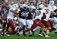 20 September 2014:  Penn State DT Austin Johnson (99) bursts into the backfield. The Penn State Nittany Lions defeated the University of Massachusetts Minutemen 48-7 at Beaver Stadium in State College, PA.